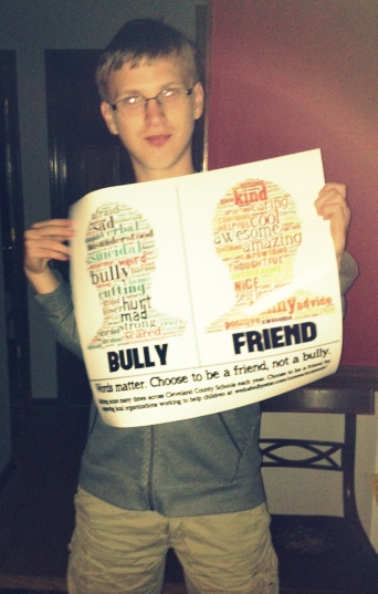 Tanner with poster