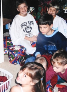First Christmas (Tanner is in the middle somewhere as they helped him open gifts)